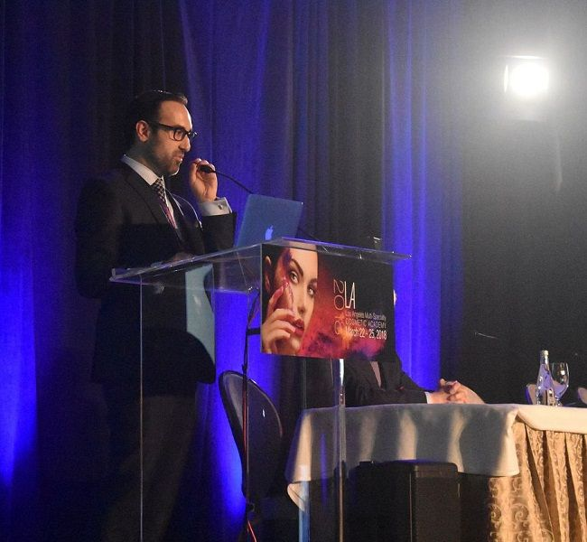 Dr Kian Karimi at conference