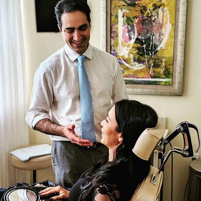 Dr Michael Omidi with his patient