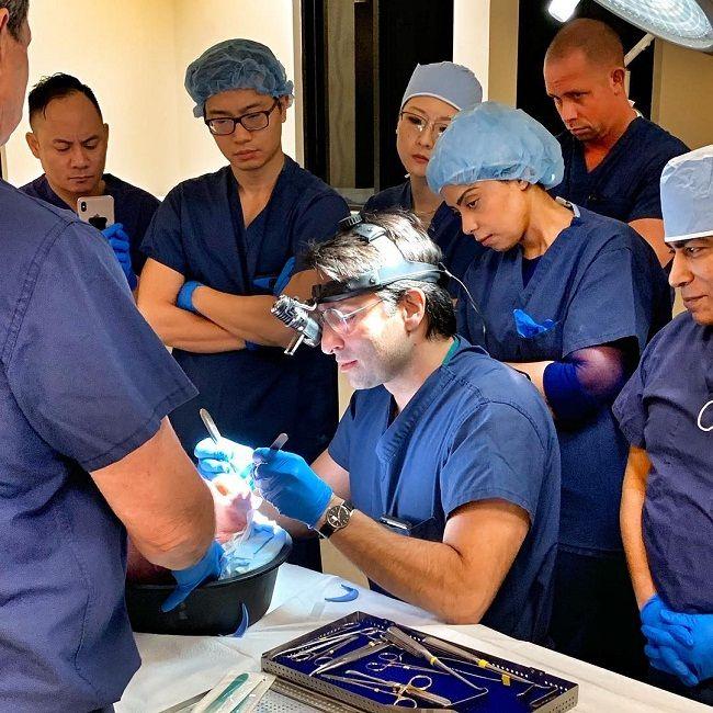 Dr. Rady Rahban explaining chin augmentation to his colleague
